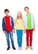 Nice young teens boys and girl hold hands - stock photo