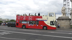 Sightseeing tour bus driving on Westminster Bridge in London Stock Footage