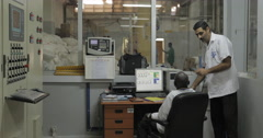Industrial Workers In Control Room (4K) Stock Footage