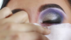 Make-up artist does the shadow on the eyes Stock Footage