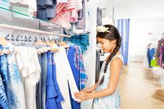 Beautiful Asian girl with flower accessory in shop Stock Photos