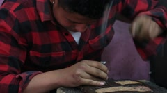 Tibetan master making souvenirs from metal. Ladakh, Leh, India Stock Footage