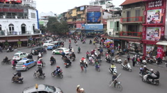 Busy rush hour traffic, dangerous intersection in Hanoi, Vietnam, Asia Stock Footage