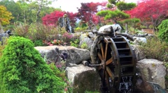 Ornamental Water mill at The Garden of Morning Calm at autumn. Gapyeong Stock Footage