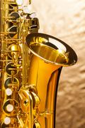 Alto saxophone with keys on silver background Stock Photos