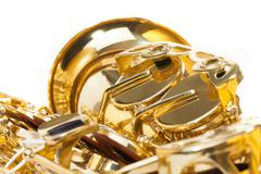 Saxophone with detailed view of keys isolated - stock photo