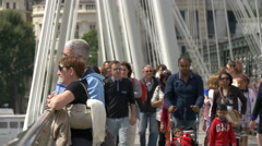 People on the Golden Jubilee Bridges in London Stock Footage