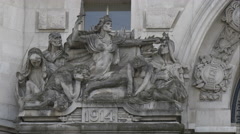Sculptures above the 1914 year on Waterloo station building, London Stock Footage