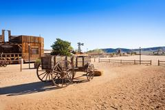 Old wooden wagon in Pioneer town - stock photo