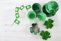 Happy St Patricks Day cooking and baking concept with green cupcake pans and  - stock photo