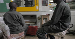 Workers Operating Machines And Checking The Quality (4K) Stock Footage