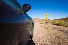 Close-up of car on the road in desert, California Stock Photos