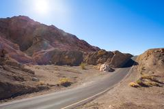 Road on artist drive between rocks in Death valley - stock photo