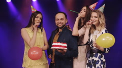 birthday with a cake and friends whistle whistle in the night club - stock footage