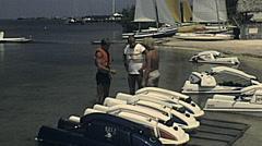 Florida 1982: young man renting a jet ski Stock Footage