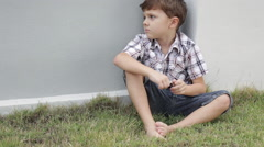 Portrait of sad little boy outdoors Stock Footage