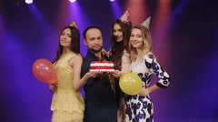 Birthday with a cake and friends posing in night club Stock Footage