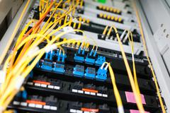 Fiber optic with servers in a technology data center - stock photo