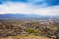 View from top of Salt Lake City with mountains - stock photo
