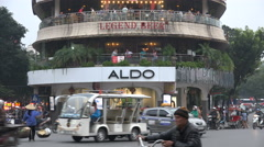 Restaurant, bars, shops, busy intersection in old quarter of Hanoi, Vietnam Stock Footage