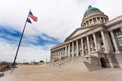 Stock Photo of Utah Capitol building with American flag on sky
