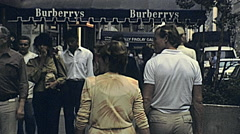 New York 1982: people walking outside Burberrys Stock Footage