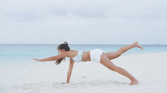 Fitness plank exercise - woman exercising on beach living healthy lifestyle. Stock Footage