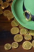 St Patricks Day hat and gold coins. - stock photo