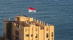 Monegasque Flag on the Top of a Building Stock Footage