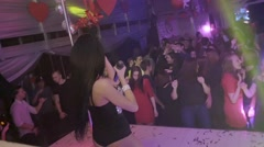 Back side MC girl in mouse ears shake shouldera on nightclub stage. Slow motion - stock footage