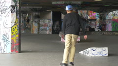 Skateboarding between the graffiti walls of London - stock footage