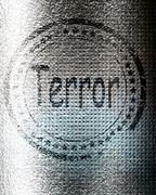 Terror stamp on a grunge background Stock Illustration