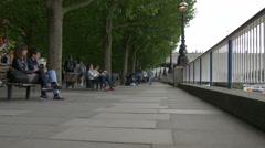 Stock Video Footage of Relaxing on the riverside near Waterloo Bridge in London