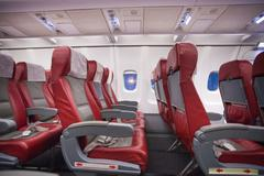 Row of empty sits in commercial jet plane - stock photo