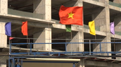 The Vietnamese flag in front of a construction site in Hanoi Stock Footage
