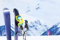 Ski with mask and pole, chairlift on background - stock photo