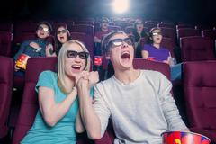 People in the cinema wearing 3d glasses Stock Photos