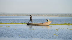 Fishermen on their boat at Murchison Falls National Park, Uganda, Africa Stock Footage