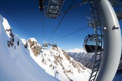 Ski lift panorama on winter resort over valley Stock Photos