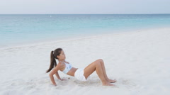 Exercise and fitness woman in exercising workout strength training on beach Stock Footage