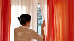 Woman is Looking Through the Window in Slow Motion Stock Footage