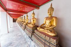 Gold buddha statue in Wat Pho - stock photo