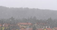 Close up footage of true natural heavy snowfall in Slovenia, Divaca. Stock Footage