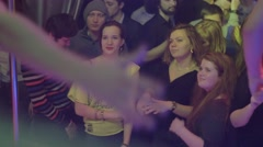 Girls watch at stripper in blue pants boxers dance in front of them in nightclub - stock footage