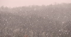 Close up footage of natural heavy snowfall in the mountains of Slovenia Stock Footage