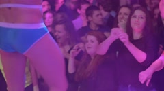 Girls dance, watch at stripper in pants boxers dance in front of them in club - stock footage