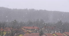 Close up footage of true natural snow falling in Slovenia, Divaca Stock Footage
