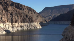 Colorado river water level on the rocks - Hoover dam hydroelectric power station Stock Footage