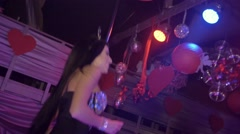 MC girl in mouse ears, sexy bodysuit sing on stage of nightclub. Audience - stock footage
