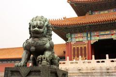 Bronze lion is guarding Forbidden City - stock photo